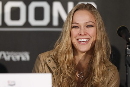 Ronda Rousey becomes first female athlete to sign with the UFC