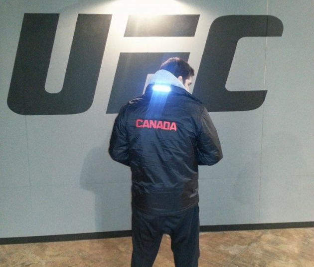 Pic:  TUF Canada coach Patrick Cote shows off Canada jacket