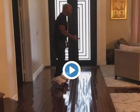 Quick Vid: Mike Tyson falls HARD riding a hoverboard